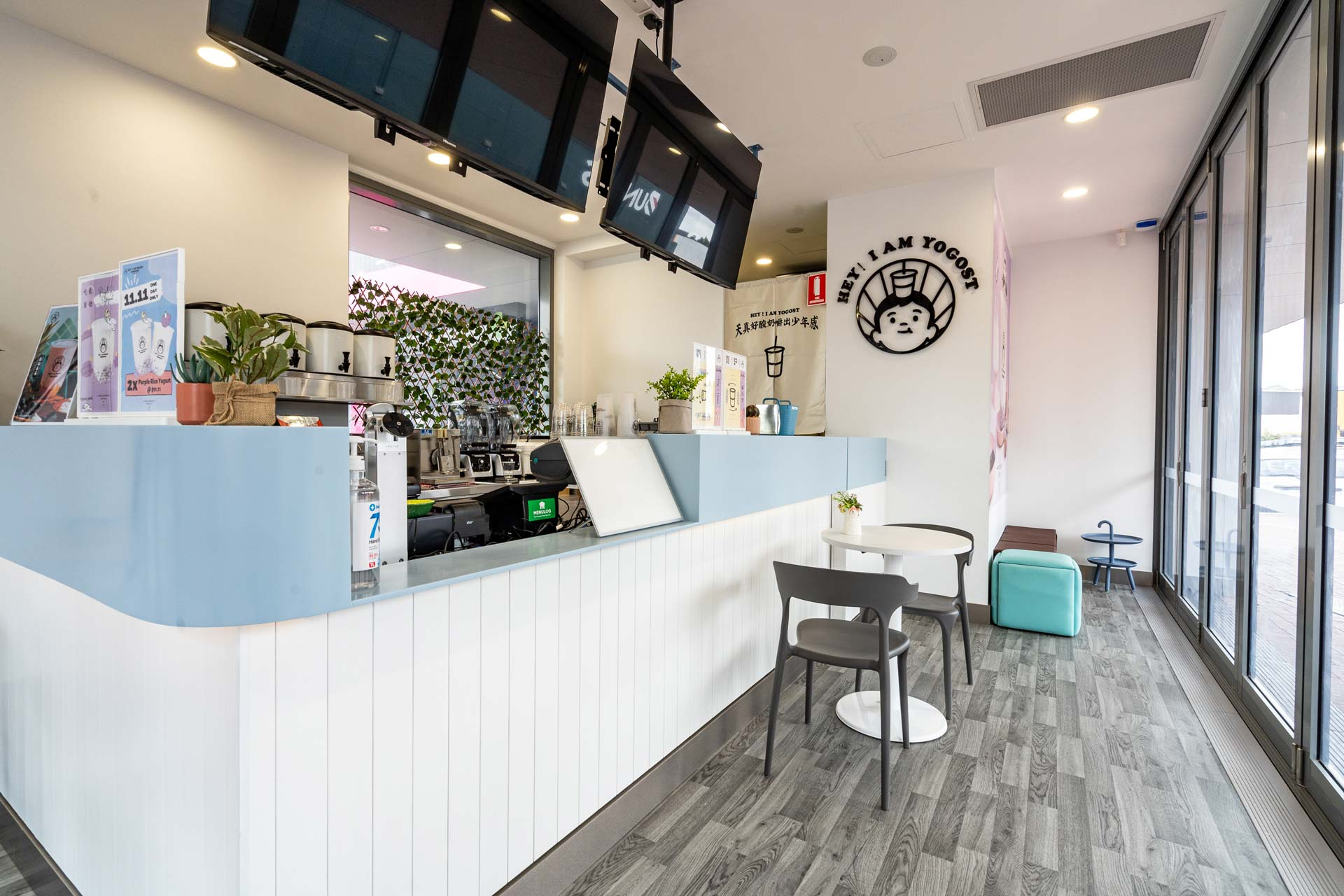 Yogost cafe with LED menu screens and a large counter area