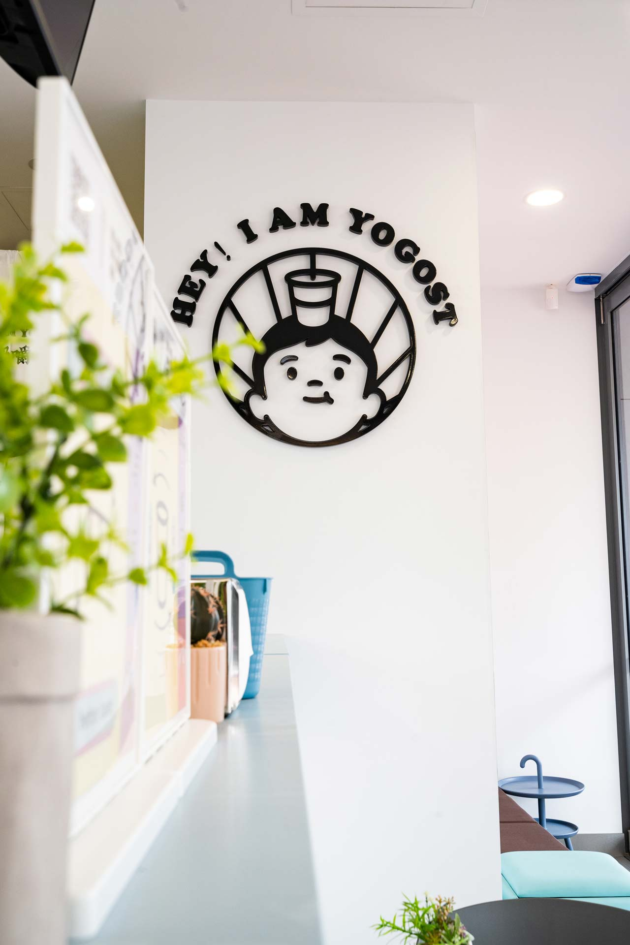 Yogost logo displayed on the cafe wall