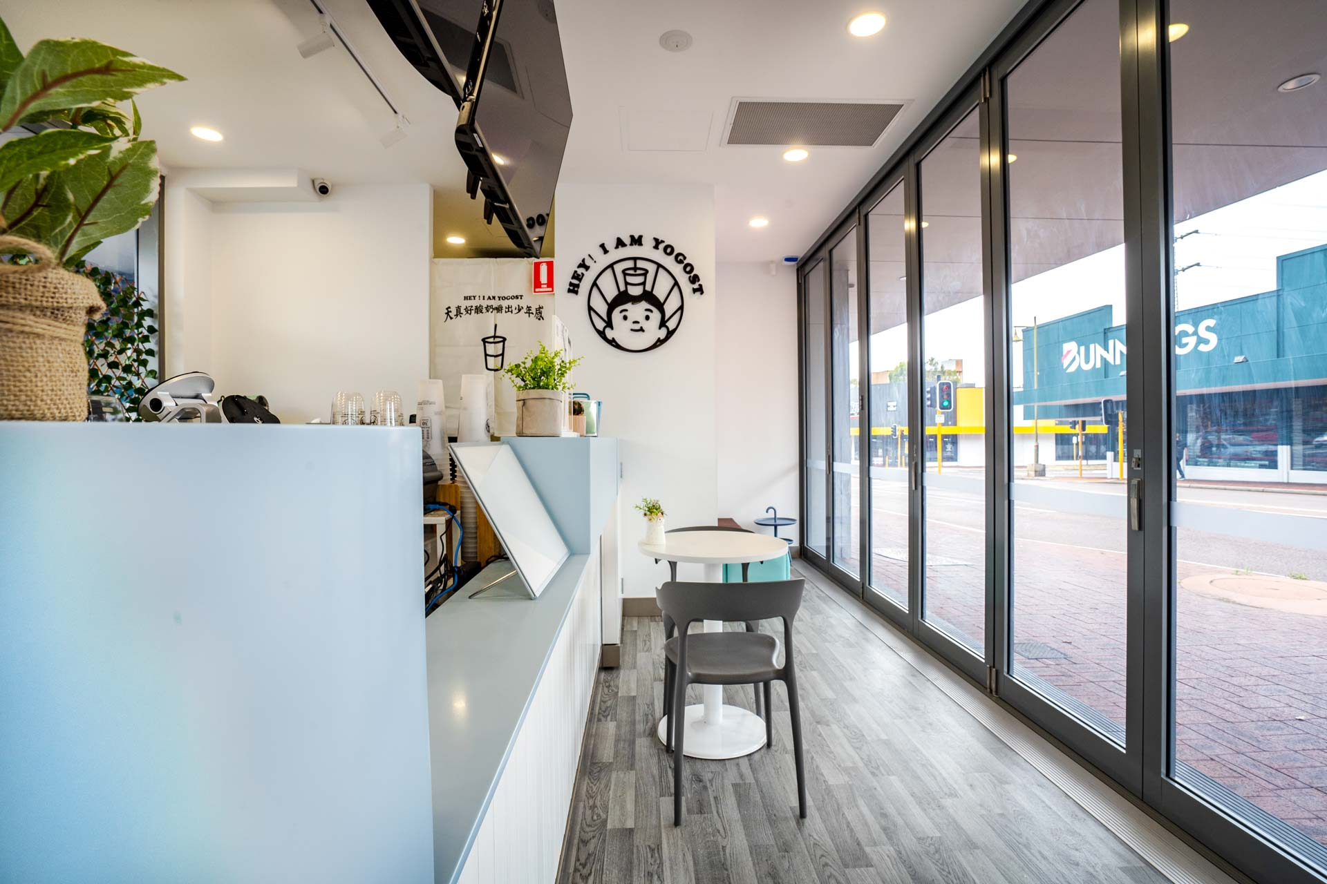Yogost cafe fitout with wood flooring and bifold doors