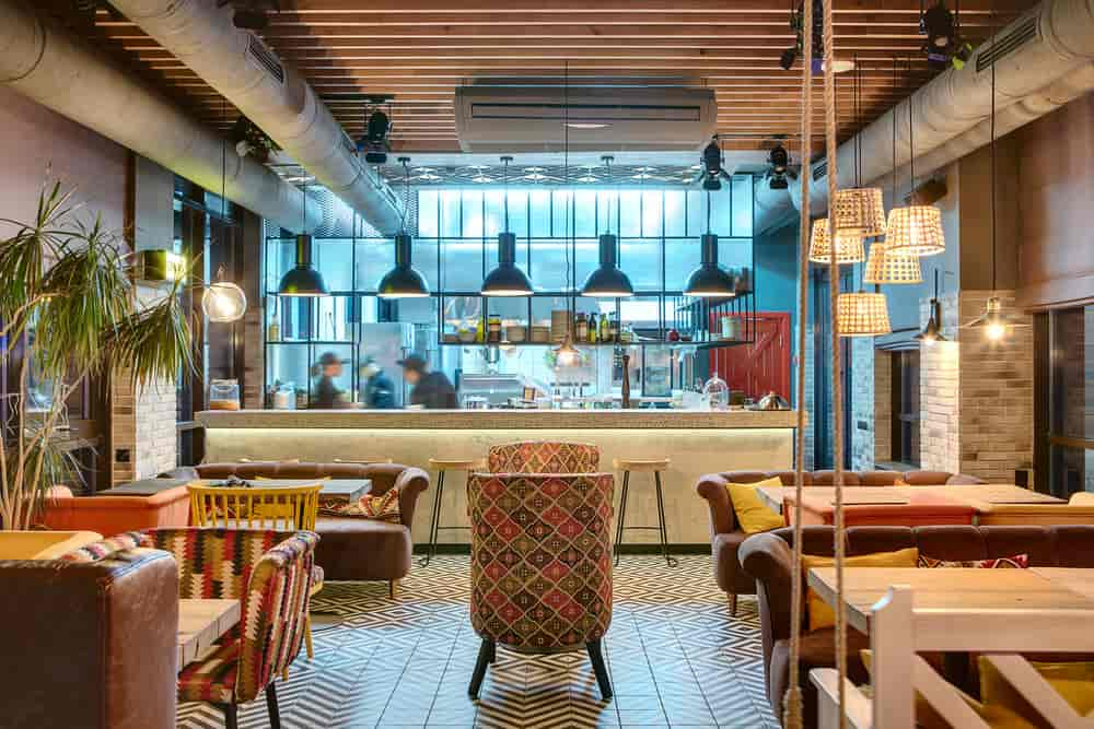 Trendy café with patted tile floors and an open kitchen