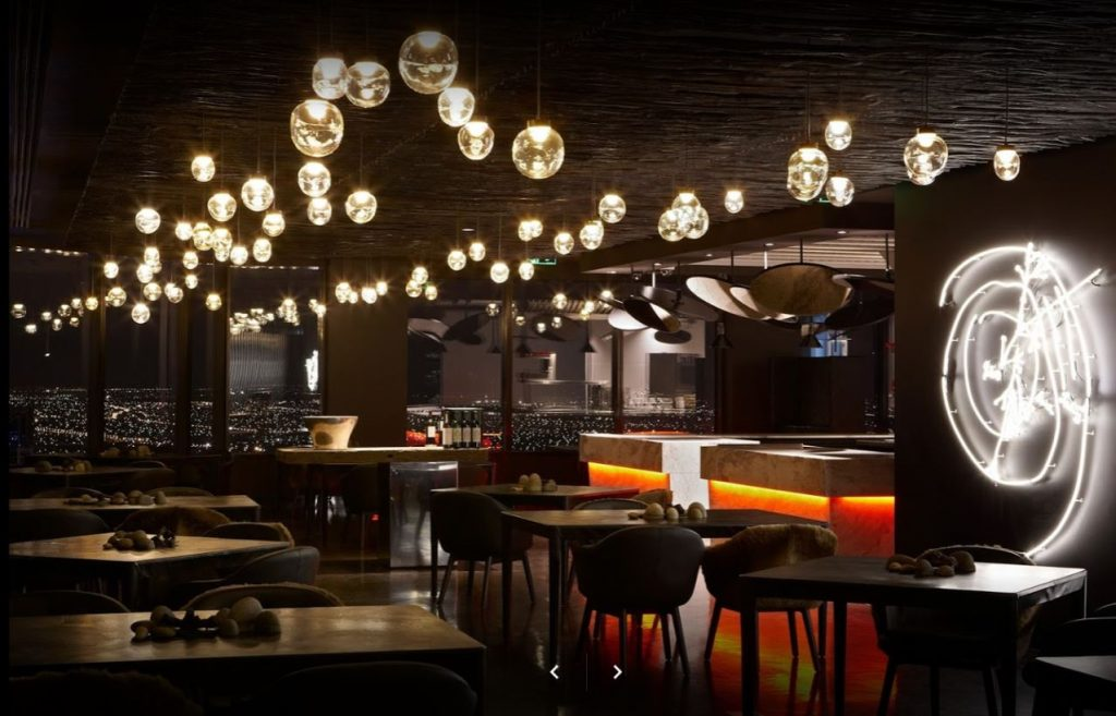 Dimly lit Perth restaurant at night with trendy light bulbs hanging from the ceiling