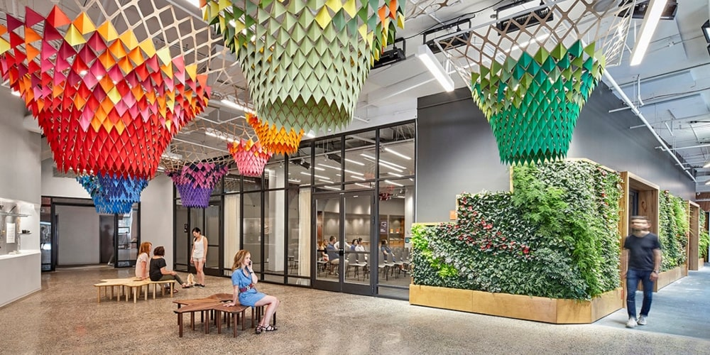 Large office walkway with avant-garde paper chandeliers hanging from the ceiling