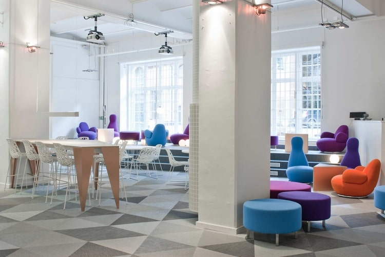 Well lit office space with bright and colorful chairs